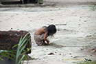 Indian son playing in the dirt Rio Negro River Brazil